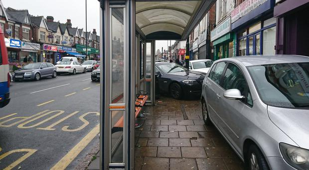 Pavement parking is a 'blight' on communities, said MPs (West Midlands Police/PA Images)