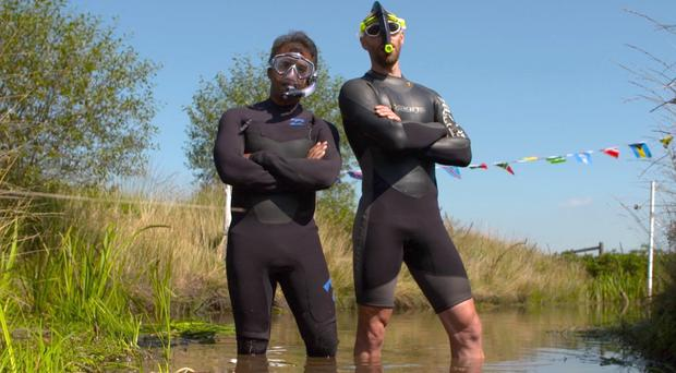 Neil Rutter (right) and Inside Out West presenter Sabet Choudhury taking part in the annual bog snorkelling world championships (BBC/PA)