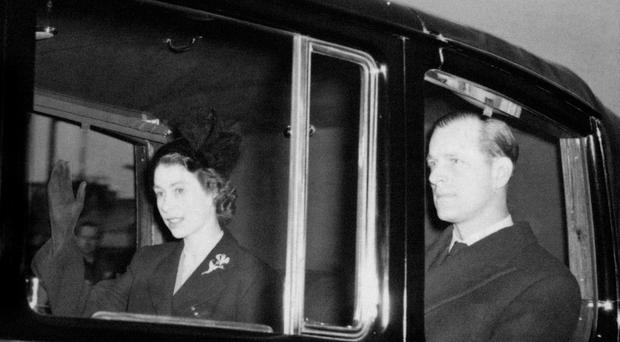 The new Queen Elizabeth II, a day after becoming the monarch, with the Duke of Edinburgh (PA)