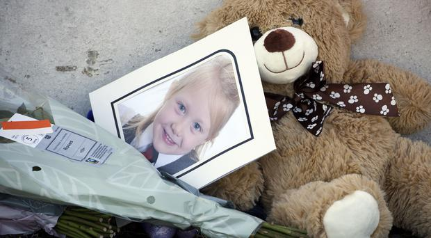 A picture of Alesha MacPhail among tributes to the young girl (John Linton/PA)