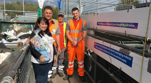 Julie Stockinger with Karl Brydon, David Cottell and Shane Arnold at Maresfield Household Waste Recycling Site (East Sussex County Council/PA)