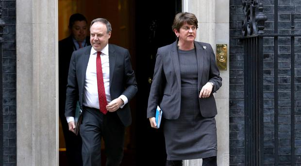 Arlene Foster and Nigel Dodds leave 10 Downing Street (Aaron Chown/PA)