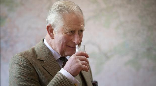 Charles on a previous visit to the Royal Lochnagar Distillery on Royal Deeside (Jane Barlow/PA)