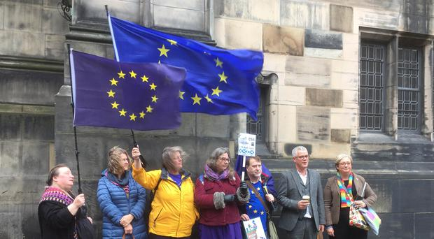 SNP MP Joanna Cherry, right, with fellow campaigners outside Court of Session in Edinburgh (Lucinda Cameron/PA)