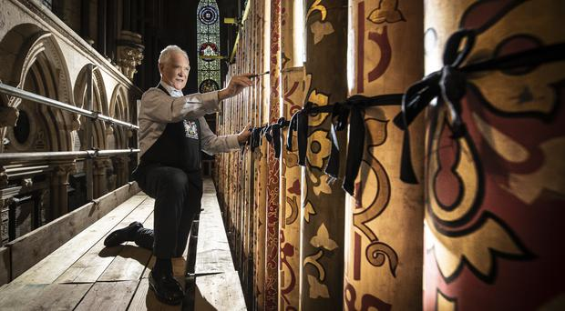 A conservation expert works on some of the case pipes, removed from York Minster's grand organ for restoration and refurbishment (Danny Lawson/PA)