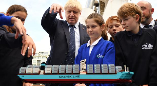 Boris Johnson takes part in an activity with school children as he visits the NLV Pharos, a lighthouse tender moored on the river Thames (Daniel Leal-Olivas/PA)