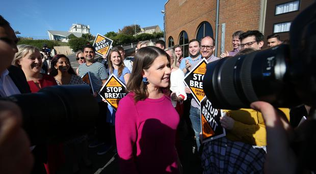 Jo Swinson (centre) is greeted by party members as she arrives for the Liberal Democrats autumn conference in Bournemouth (Jonathan Brady/PA)