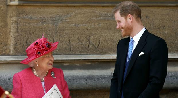 The Duke of Sussex talks to his grandmother the Queen at Lady Gabriella Windsor's wedding (Steve Parsons/PA)