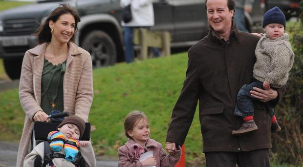 David Cameron in 2007, with his wife Samantha and children Ivan, Nancy and Elwen (Stefan Rousseau/PA)