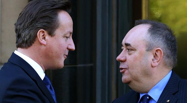 David Cameron (left) described Alex Salmond as being the 'slipperiest of characters'. (Andrew Milligan/PA)