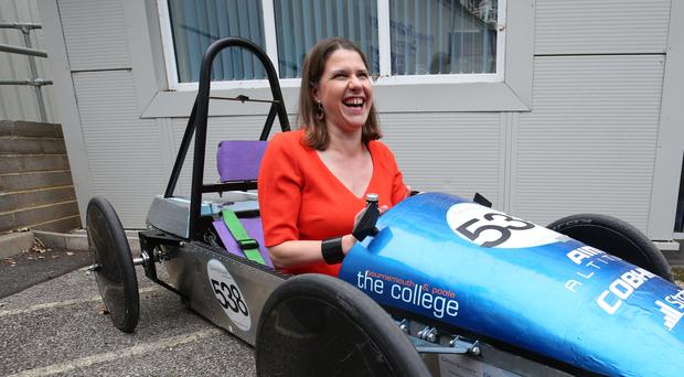 Jo Swinson enjoys trying out a battery-powered green energy car (Jonathan Brady/PA)