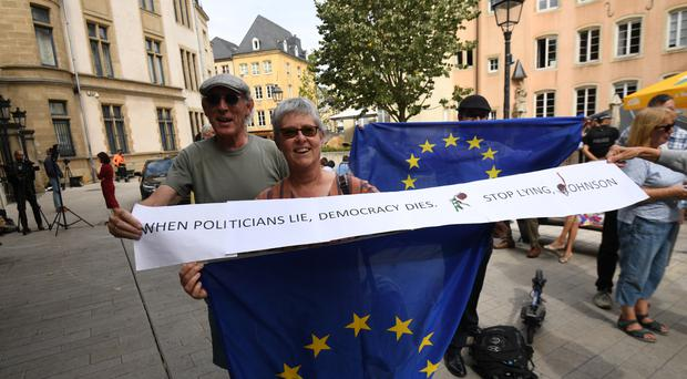 Protesters outside Le Bouquet Garni restaurant in Luxembourg (Stefan Rousseau/PA)
