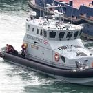 A small boat is towed into the Port of Dover in Kent after a small boat was found in the Channel (Gareth Fuller/PA)