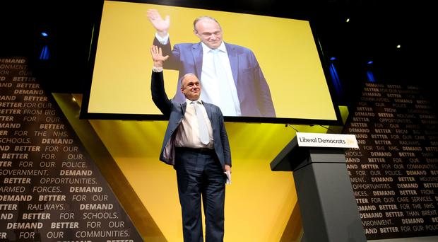 Sir Ed Davey receives applause following his speech at the Liberal Democrats conference (Jonathan Brady/PA)