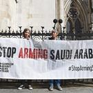 Protesters outside the Royal Courts of Justice ahead of the ruling (PA)