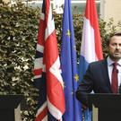 Xavier Bettel addresses a media conference next to an empty lectern intended for Boris Johnson (Olivier Matthys/AP)