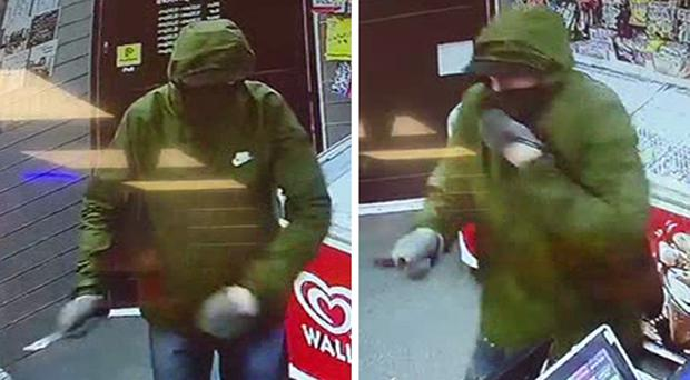 Handout CCTV images dated 16/9/2019 of masked robber during a robbery at the Express Supermarket in Worthing. An 11-year-old girl scared off the armed robber by throwing bread at him with her dad. (Sussex Police/PA)