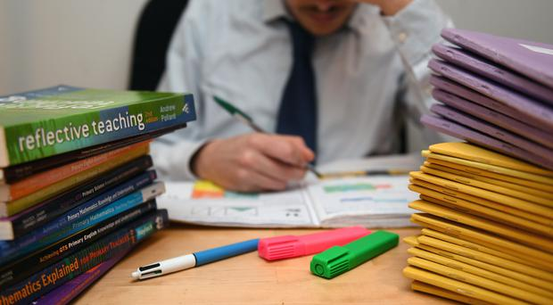 The average full-time secondary teacher in England worked 49 hours per week last year (PA)