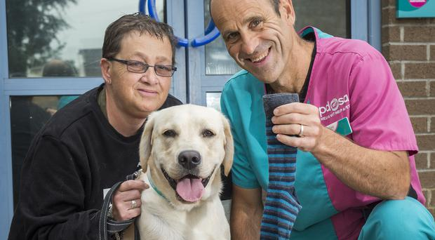 Owner Maxine Holliday with Rocky and PDSA vet Manolo Hervada-Gonzalez (PDSA/PA)