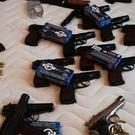 Some of the 56 guns seized in raids in the UK and Bulgaria (NCA/PA)