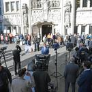 Members of the media and protesters outside the Supreme Court in London (PA)