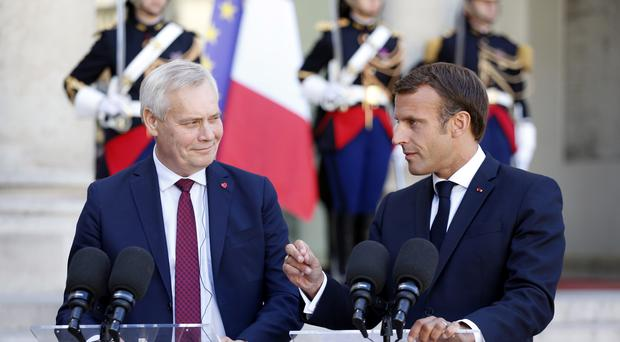 France's president Emmanuel Macron and prime minister of Finland Antti Rinne held talks in Paris (Thibault Camus/AP)