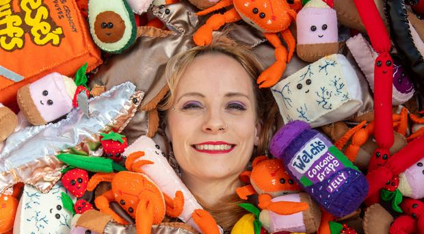 Contemporary British artist Lucy Sparrow amongst some of her felt art pieces at her workshop in Suffolk (Joe Giddens/PA)