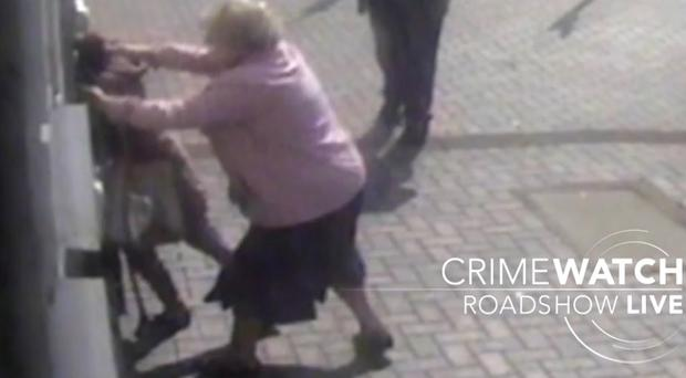 Doreen Jones takes hold of her attacker (BBC Crimewatch Roadshow Live/PA)