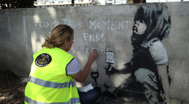 The famed graffiti artist painted the image in Marble Arch (Yui Mok/PA)