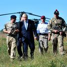 PM Boris Johnson arrives by helicopter to visit military personnel at Salisbury Plain training area yesterday