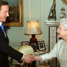David Cameron with the Queen in 2010 (John Stillwell/PA)