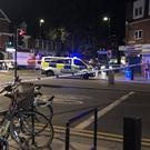 A police cordon down at the scene of the shooting by Turnpike Lane station. Markers have been placed at different points in the road.The shooting is understood to have taken place outside the Tasty Kebabs and Chicken shop opposite the station (Tess De La Mare/PA)