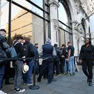 Customers are applauded as they arrive to collect their pre-orders for new Apple products at the tech giant's flagship store in Regent Street, central London (Jonathan Brady/PA)