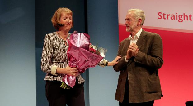 Harriet Harman receives flowers from Jeremy Corbyn in tribute to her service to the Labour Party (Jonathan Brady/PA Wire)