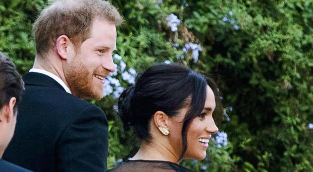 Harry and Meghan at the wedding of Misha Nonoo – who set them up in 2016 (Claudio Peri/AP)