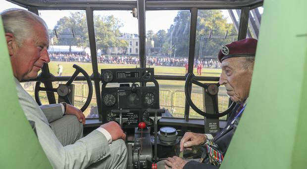 Prince Charles talks to veteran gilder pilot Frank Ashleigh in the cockpit of one of the aircraft (Steve Parsons/PA)