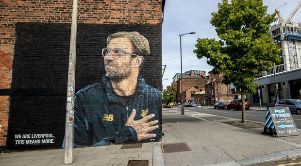 Liverpool FC manager Jurgen Klopp features on the side of a garage in the Baltic Triangle area of Liverpool (Peter Byrne/PA)