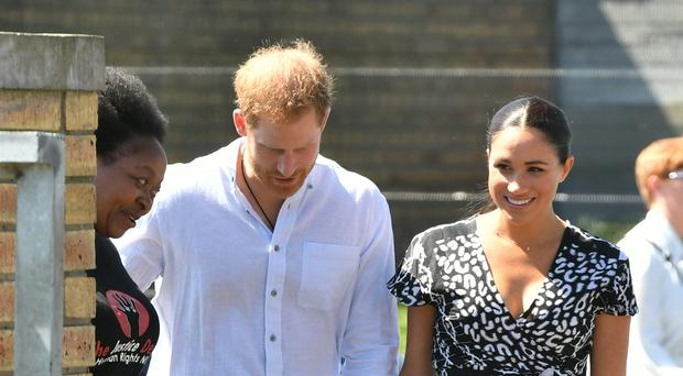The Duke and Duchess of Sussex arrive at the Nyanga Township (Dominic Lipinski/PA)