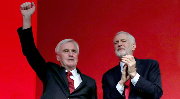 John McDonnell and Jeremy Corbyn on stage at the Labour conference (Gareth Fuller/PA)