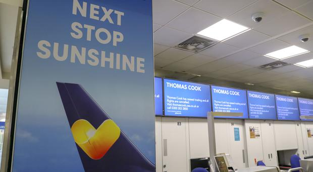 Empty Thomas Cook check-in desks at Gatwick (Steve Parsons/PA)