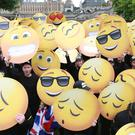 More than a fifth of adults often use emojis, GIFs and memes, rather than words, according to a poll (Matt Alexander/PA)
