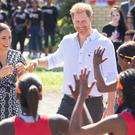 The Duke and Duchess of Sussex meet a group of dancers at the Nyanga Township in Cape Town (Dominic Lipinski/PA)