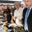 Prime Minister Boris Johnson talks to the media on board his plane as he flies to New York where he will attend the 74th Session of the UN General Assembly.