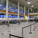 Empty Thomas Cook check-in desks at Gatwick Airport (Steve Parsons/PA)