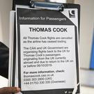 An information notice is held up at Manchester Airport as Thomas Cook ceases trading (Peter Byrne/PA)