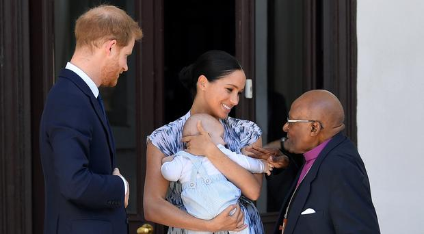 The Duke and Duchess of Sussex hold baby Archie as they meet Archbishop Desmond Tutu in Cape Town (Toby Melville/PA)
