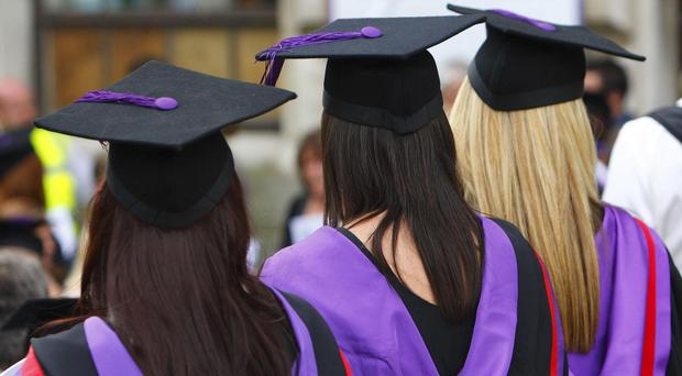 For the first time, more than 50% of young adults are getting university-level education (Chris Ison/PA)