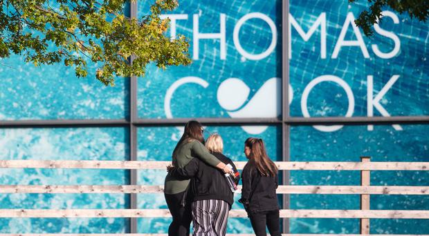 People outside the Peterborough headquarters of tour operator Thomas Cook, which is now under scrutiny by the BEIS Select Committee (Joe Giddens / PA)