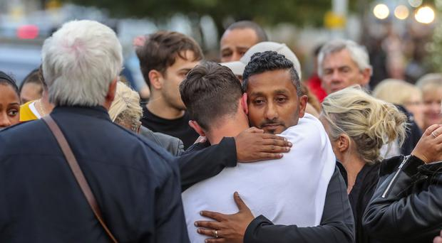Family and friends of Tashan Daniel, who was stabbed at Hillingdon station (Steve Parsons/PA)