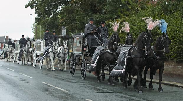 The funeral procession leaves St Paul's Church, Walkden (Danny Lawson/PA)